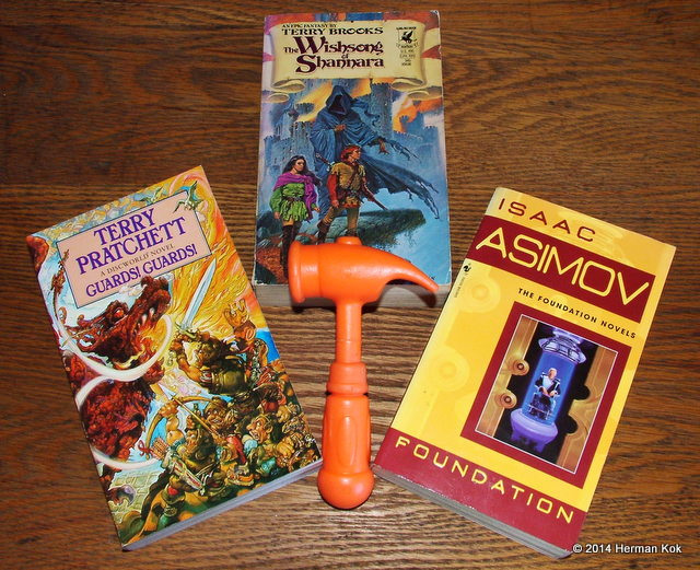 Guards Guards by Terry Pratchett, Wishsong of Shannara by Terry Brooks, Foundation by Isaac Asimov